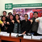 Representatives of the #NoTo550 Coalition and Bishop Ruperto Santos of the Catholic Bishops Conference of the Philippines (CBCP) gave a thumbs down gesture to show their solidarity against the government's move to integrate the airport terminal fee in all air tickets on February 1 despite a law exempting OFWs from paying the PHP550 airport fee during a presscon earlier at the CBCP building in Intramuros, Manila.